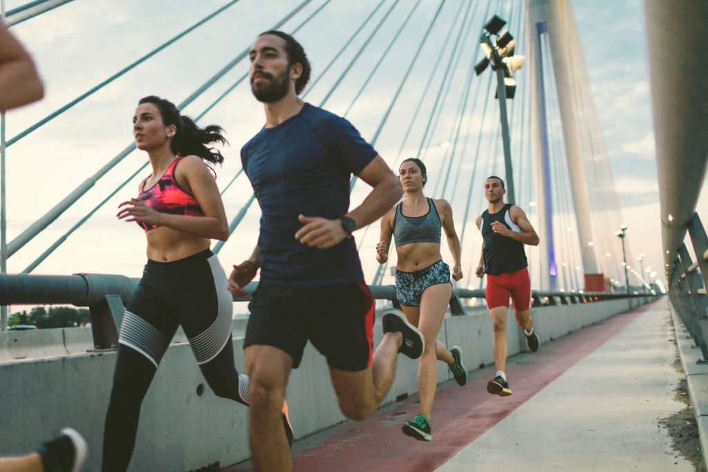 Runners with exercise-induced asthma run across a bridge.