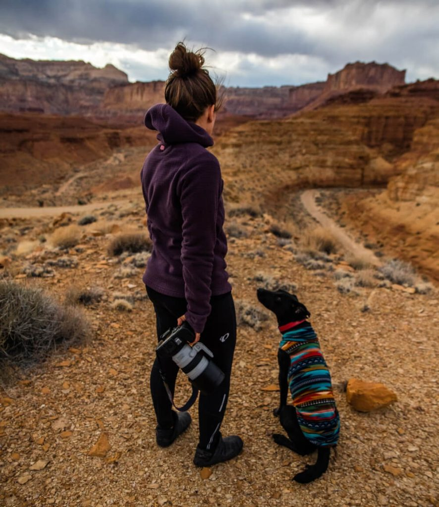 A woman with asthma hikes with her dog.