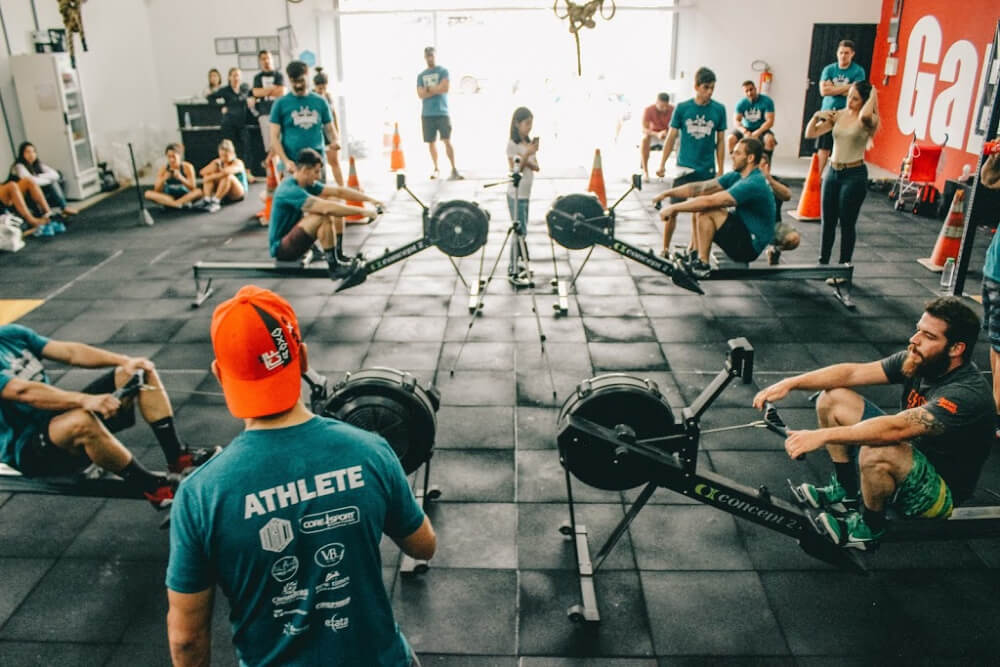 People with asthma complete a rowing workout at a Crossfit gym.